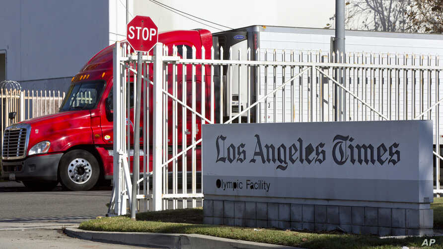 A truck is parked outside a Los Angeles Times facility in Los Angeles, Dec. 30, 2018. A computer virus hit the newspaper printing plant in Los Angeles, and at Tribune Publishing newspapers across the country.