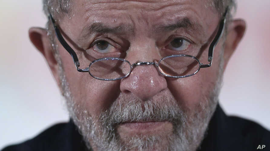 Brazil's former President Luiz Inacio Lula da Silva looks during an event with rural workers in Brasilia, March 13, 2017.