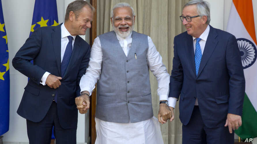 Indian Prime Minister Narendra Modi, centre, talks with European Council President Donald Tusk, left, and European Commission President Jean-Claude Juncker before their meeting in New Delhi, India, Oct. 6, 2017.