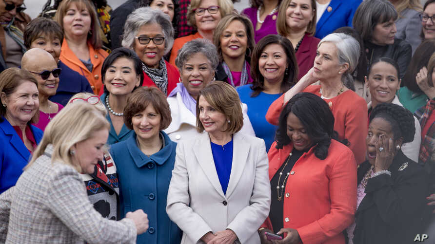 House Speaker Nancy Pelosi of Calif. arrives for a group photo with the House Democratic women members of the 116th Congress on the East Front Capitol Plaza on Capitol Hill in Washington, Jan. 4, 2019, as the 116th Congress begins.