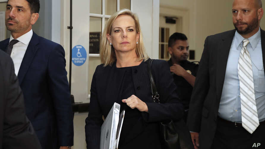 Homeland Security Secretary Kirstjen Nielsen, center, arrives for a closed doors meeting with the Congressional Hispanic Caucus, July 25, 2018, on Capitol Hill in Washington.
