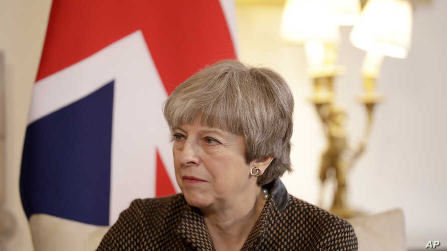 """FILE - British Prime Minister Theresa May is seen during a meeting at 10 Downing Street in London, Britain, Nov. 27, 2017. In a rare rebuke, May has called President Donald Trump's retweeting of anti-Muslim videos """"wrong."""""""