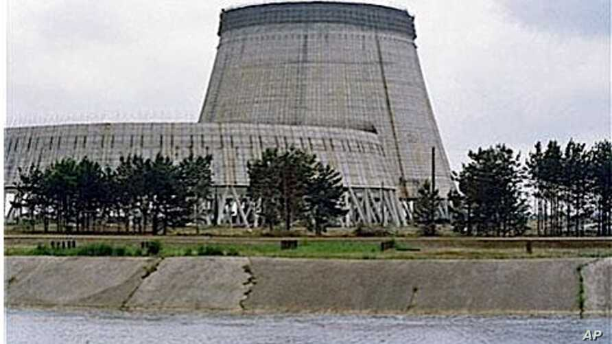 Reactor No. 4 of the Chernobyl nuclear power plant stands encased in lead and concrete following the April 1986 accident, which released a cloud of radiation that circled the world in Pripyat, 1988 (file photo)
