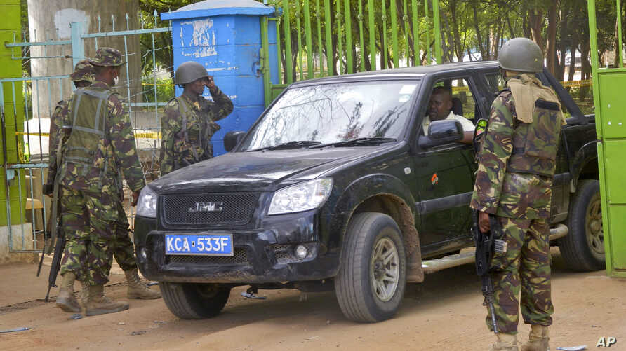 Kenya Defence Forces (KDF) guard the main gate of the Garissa University College compound that was the scene of a recent attack by al-Shabab gunmen, in Garissa, April 6, 2015.