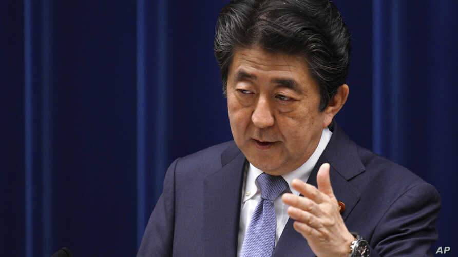 Japan's Prime Minister Shinzo Abe answers a question from a journalist during a press conference at the prime minister's official residence in Tokyo, July 20, 2018.