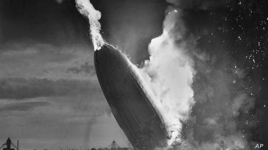 FILE - In this May 6, 1937 file photo, the German dirigible Hindenburg crashes to earth in flames after exploding at the U.S. Naval Station in Lakehurst, N.J. Only one person is left of the 62 passengers and crew who survived when the Hindenburg burs
