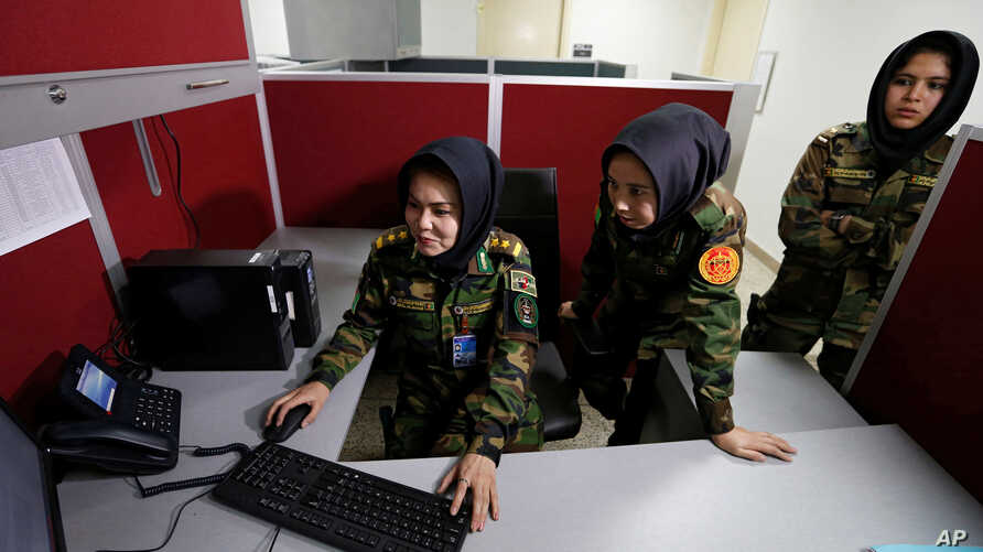 Second Lieutenant Roshan Gul, from left, First Lieutenant Nelofar Frotan and Second Lieutenant Morsal Afshar work at the human resources office in the Ministry of Defense in Kabul, Afghanistan, Oct. 31, 2016.