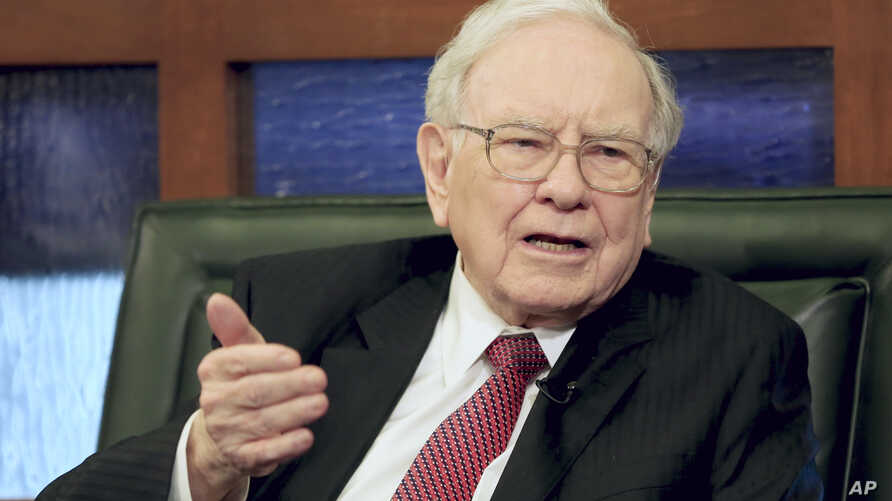 FILE - Berkshire Hathaway Chairman and CEO Warren Buffett speaks during an interview with Liz Claman on the Fox Business Network in Omaha, Neb.
