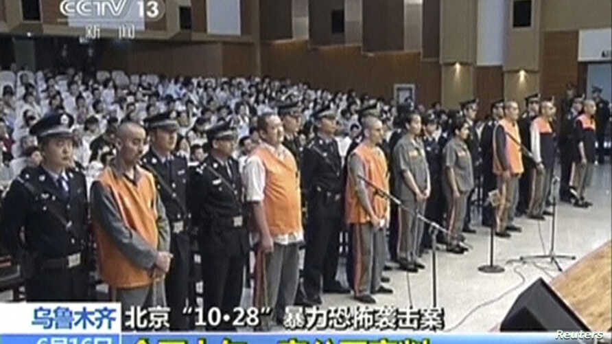 FILE - The trial of three people sentenced to death for their roles in an October attack on the edge of Beijing's Tiananmen Square is seen in this still image taken from video in Urumqi city, June 16, 2014.