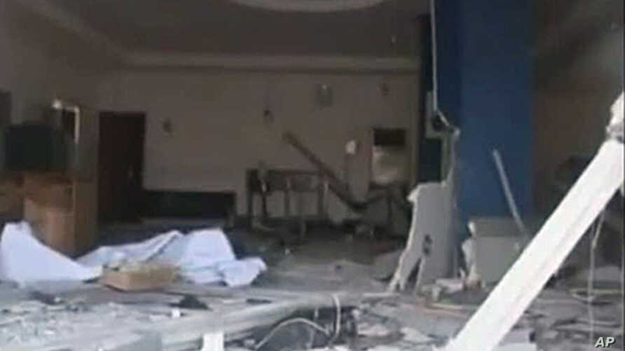 In this image made from television released by the state-run Nigerian Television Authority, Nov. 6, 2011, a damaged building is seen in Damatura, Nigeria, following a series of coordinated attacks Friday.