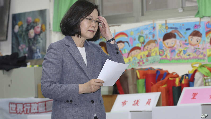 Taiwanese President Tsai Ing-wen waits to cast her ballot at a polling station, Saturday, Nov. 24, 2018, in Taipei, Taiwan.