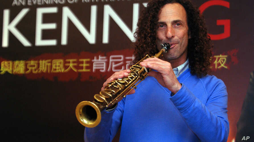 FILE - Jazz saxophonist Kenny G performs during a media event announcing his 2010 concert in Taiwan.