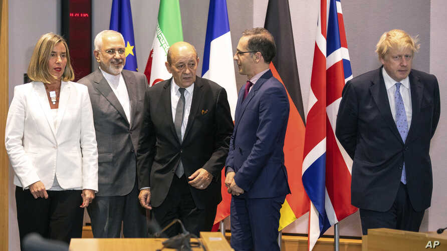 (L-R) European Union foreign policy chief Federica Mogherini,  Iranian Foreign Minister Javad Zarif, French Foreign Minister Jean-Yves Le Drian, German Foreign Minister Heiko Maas and British Foreign Secretary Boris Johnson pose for a photo during a