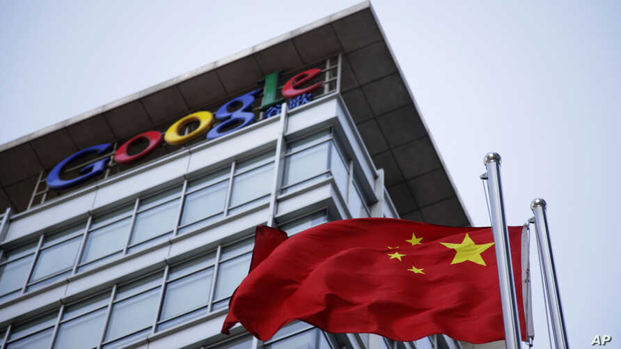 FILE - The Chinese flag is seen near the Google sign at the Google china headquarters in Beijing, China.