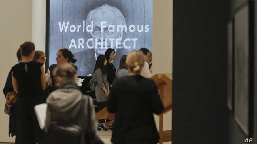 """A video showing architect Frank Lloyd Wright as the mystery guest on the 1956 television show """"What's My Line?"""", plays during a press preview for the MOMA exhibition """"Frank Lloyd Wright at 150: Unpacking the Archive,"""" June 8, 2017, in New York."""