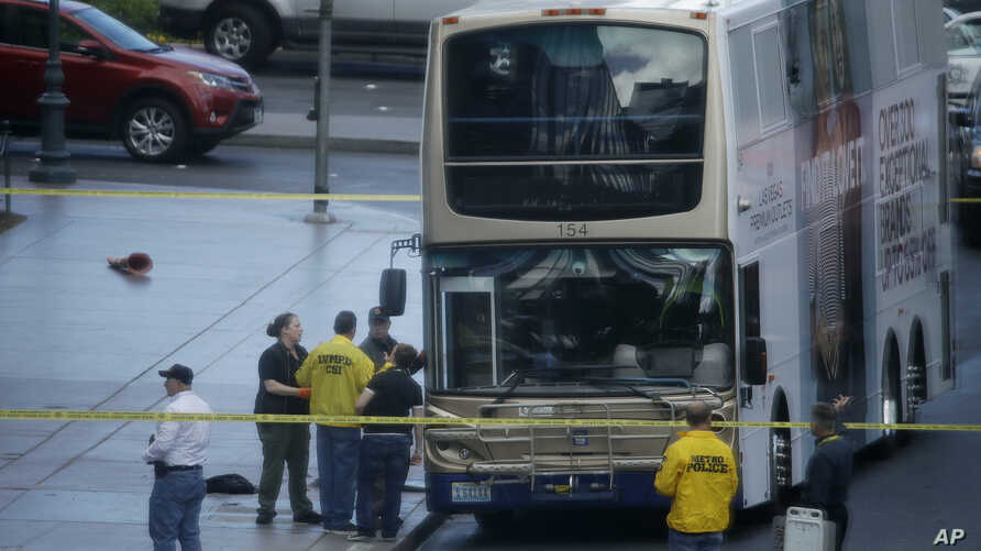 Las Vegas police investigate the scene of a stand-off in a bus along Las Vegas Boulevard in Las Vegas, March 25, 2017.