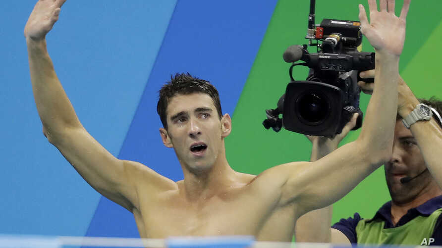 United States Michael Phelps acknowledges the crowd after his team won gold - 2016 Summer Olympics