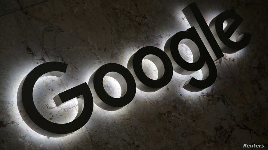 FILE - A Google logo is displayed at the entrance to the internet based company's offices in Toronto, Ontario, Sept. 9, 2018.