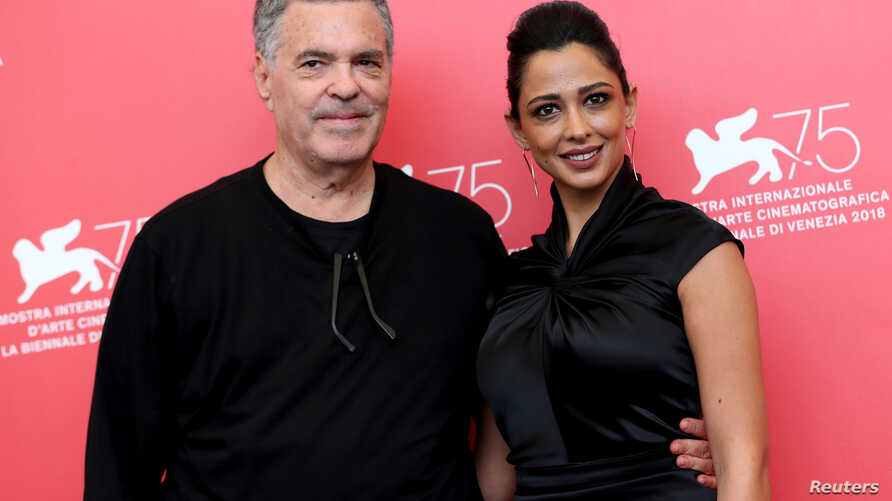 "Director Amos Gitai and actor Maisa Adb Elhadi are pictured during a photo call for the films ""A Letter to a Friend in Gaza"" and ""A Tramway in Jerusalem"" at the 75th Venice International Film Festival, Sept. 3, 2018."