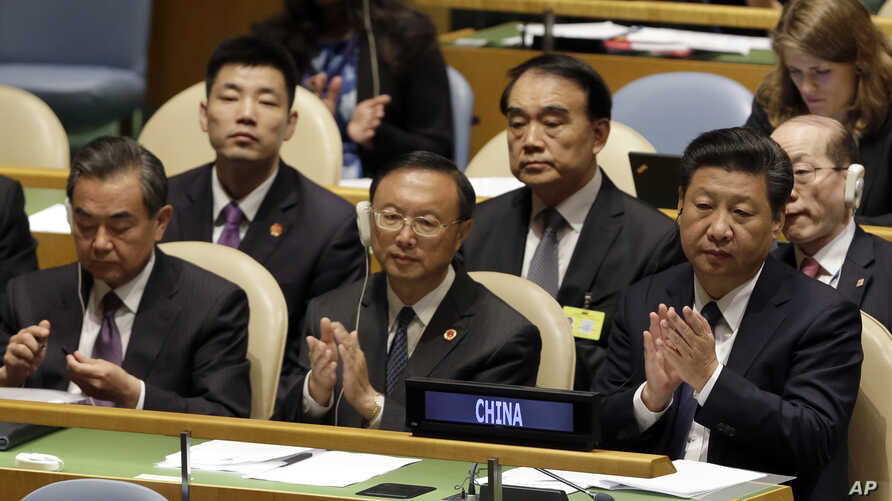 Chinese President Xi Jinping, right, attends the Sustainable Development Summit 2015, Sept. 26, 2015 at United Nations headquarters.
