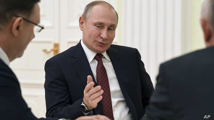 Russian President Vladimir Putin gestures as he speaks during a meeting with opposition candidates who ran against him in the presidential election.