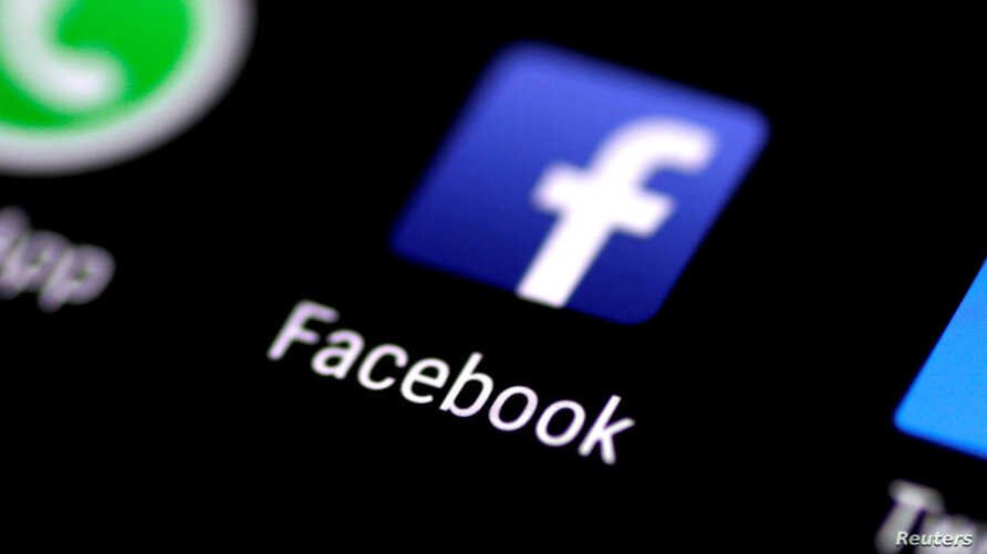 FILE: The Facebook application is seen on a phone screen Aug. 3, 2017.