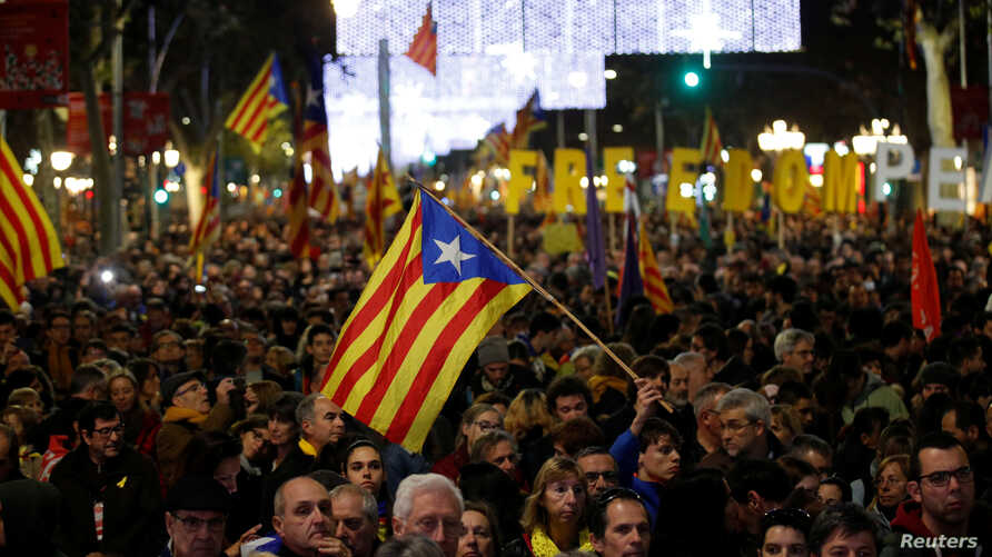 FILE - Demonstrators march during a protest after Spain's cabinet meeting in Barcelona, Spain, Dec. 21, 2018.