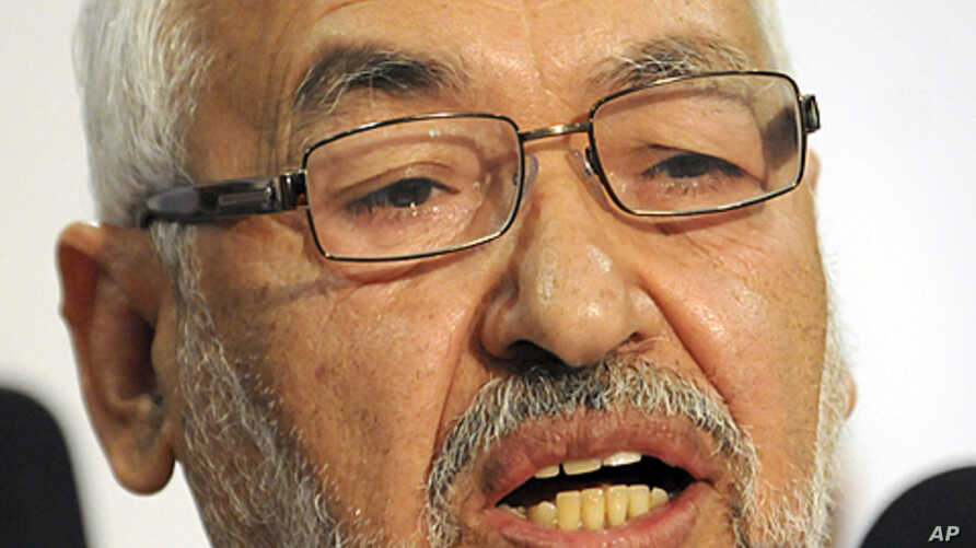 The leader and founder of the moderate Islamic party Ennahda, Rachid Ghannouchi, addresses the media during a press conference held in Tunis, October 28, 2011.