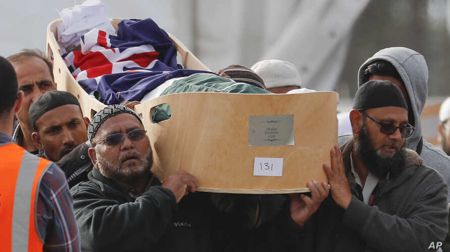 Mourners carry a victim of the March 15 mosque shootings for burial at the Memorial Park Cemetery in Christchurch, New Zealand, March 22, 2019. A mass funeral was held to bury 26 of the victims at the cemetery where more than a dozen already have bee