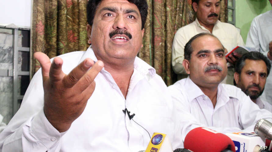 Jamil Afridi, left, brother of a Pakistani doctor, Shakil Afridi, holds a a news conference in Peshawar, Pakistan, May 28, 2012.