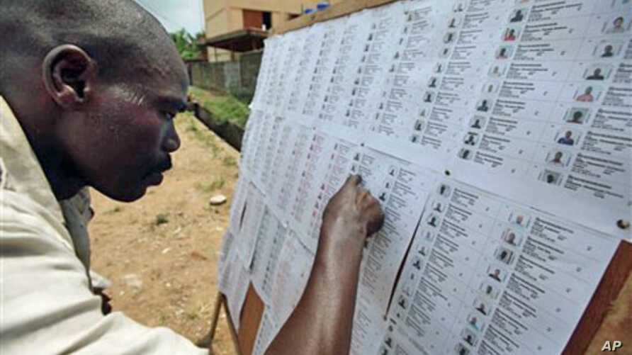 A resident checks for his name on a voters' registration list in Lagos, Nigeria, February 18, 2011