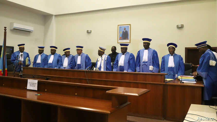 Congolese Judges of the Constitutional Court stand to leave after addressing the court session where they confirmed Felix Tshisekedi's victory in the presidential election in Kinshasa, Democratic Republic of Congo, Jan. 20, 2019.