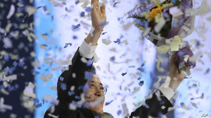South Korea's opposition Democratic Party leader Moon Jae-in celebrates after winning the nomination as the party's presidential candidate during a party's presidential primary in Seoul, South Korea, April 3, 2017.