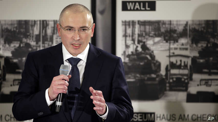 Mikhail Khodorkovsky speaks during his first news conference after his release in Berlin, Sunday, Dec. 22, 2013. The former oil baron and prominent critic of Russian President Vladimir Putin, Mikhail Khodorkovsky, was reunited with his family in Berl