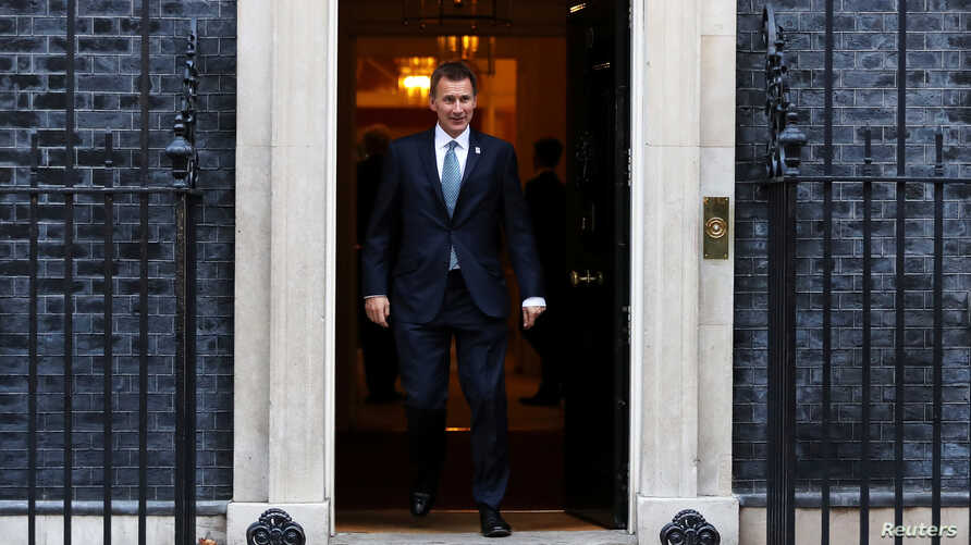 FILE - Britain's Foreign Secretary Jeremy Hunt leaves 10 Downing Street, London, Britain, Nov. 13, 2018.