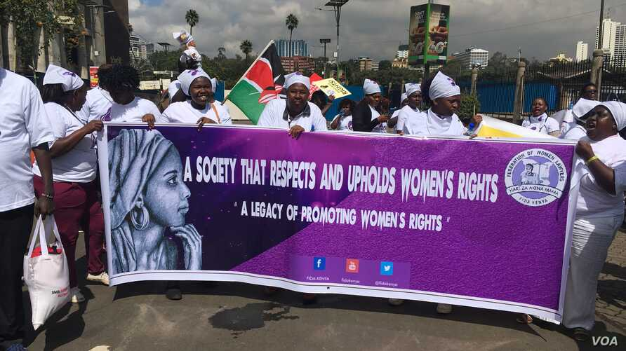 Women demonstrators, including Members of the Kenya Association of Breastfeeding Mothers, hold a protest march in Nairobi, Kenya, May 15, 2018, against a restaurant that allegedly asked a breastfeeding mother to 'Cover up or breastfeed in the toilet.