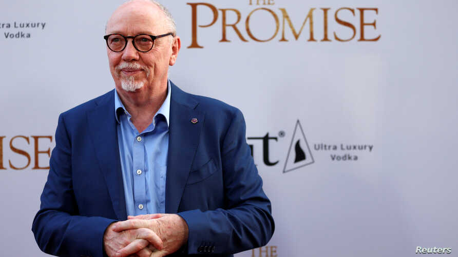 "Director of the movie Terry George poses at the premiere of ""The Promise"" in Los Angeles, California, April 12, 2017."