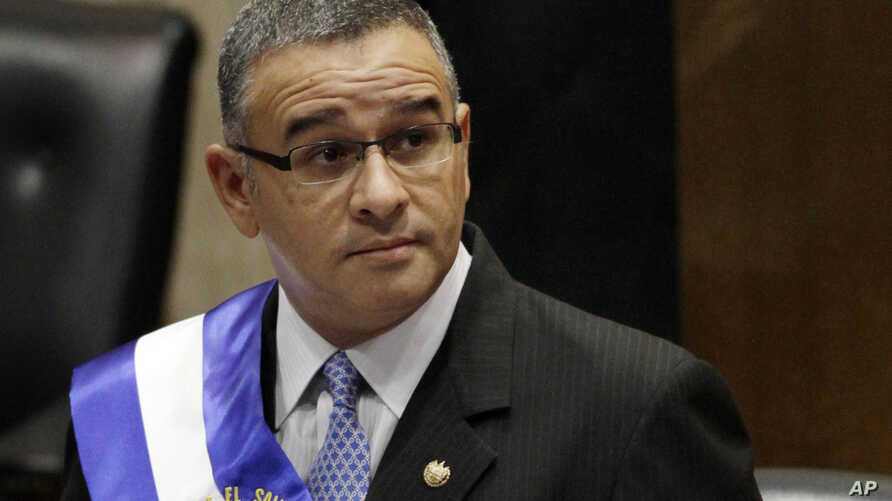 FILE - El Salvador's President Mauricio Funes stands in the National Assembly before speaking to commemorate the anniversary of his third year in office in San Salvador, El Salvador, June 1, 2012. Prosecutors in El Salvador say arrest warrants have b