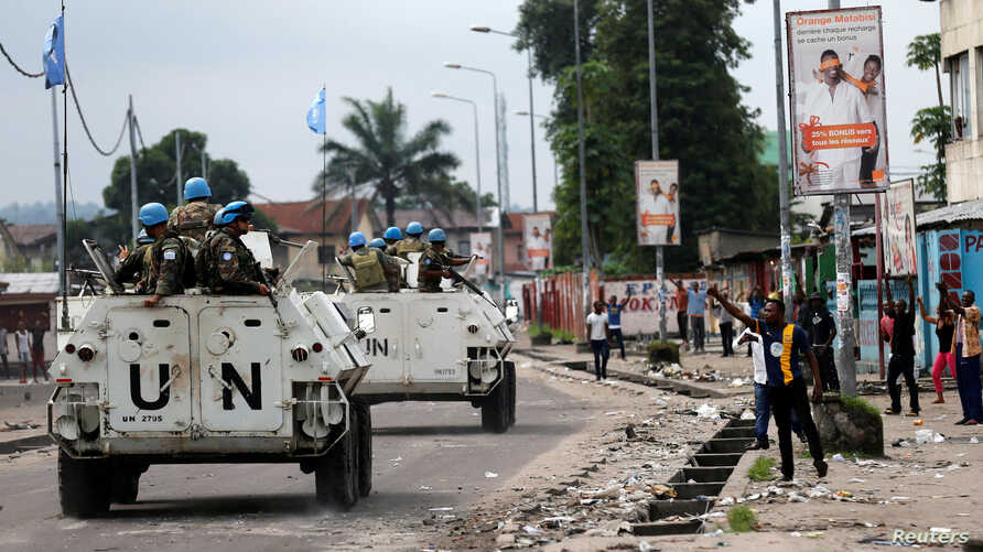 Peacekeepers serving in the United Nations Organization Stabilization Mission in the Democratic Republic of the Congo (MONUSCO) patrol in their armored personnel carrier during demonstrations against Congolese President Joseph Kabila in the streets o