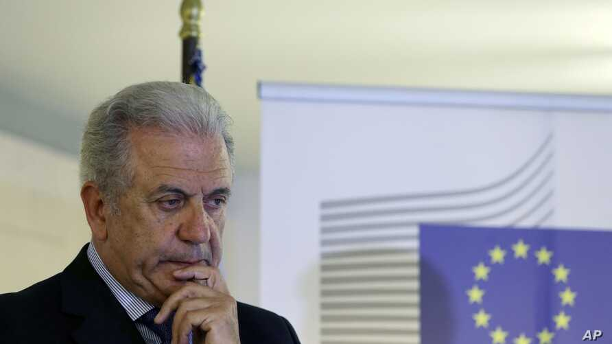 """EU Migration Commissioner Dimitris Avramopoulos, shown at a news conference after a meeting with local officials in Athens on June 12, 2015, says that """"now is the moment for actions"""" on migrant redistribution. """"We should not waste any more time."""""""