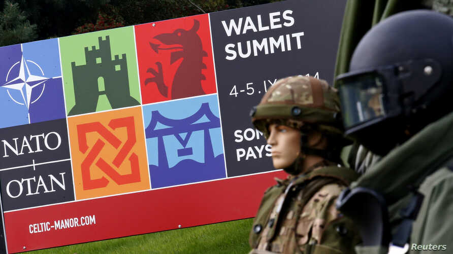 Mannequins of British soldiers dressed in combat gear are displayed at the entrance of the golf course of the Celtic Manor Hotel ahead of the NATO summit in Newport, Wales, September 3, 2014.