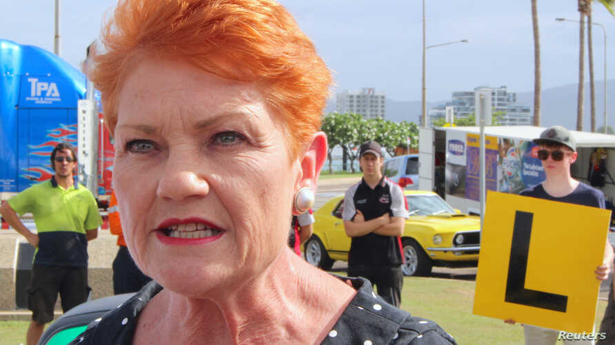FILE - Australian Senator Pauline Hanson talks with members of the media in Townsville, Queensland, Australia, Nov. 10, 2017.