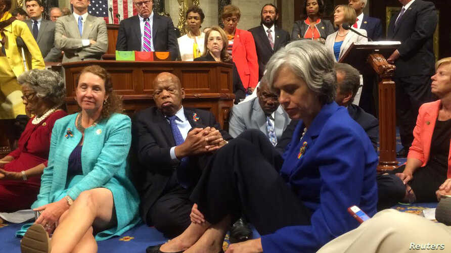 "A photo shot and tweeted from the floor of the U.S. House of Representatives shows Democratic members of the House staging a sit-in on the House floor ""to demand action on common sense gun legislation"" on Capitol Hill, in Washington, June 22, 2016.  ..."