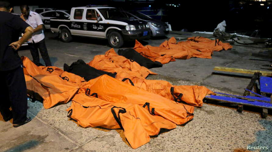 A view of the bodies of dead migrants that were recovered by the Libyan coastguard after a boat sank off the coastal town of Zuwara, west of Tripoli, August 27, 2015.