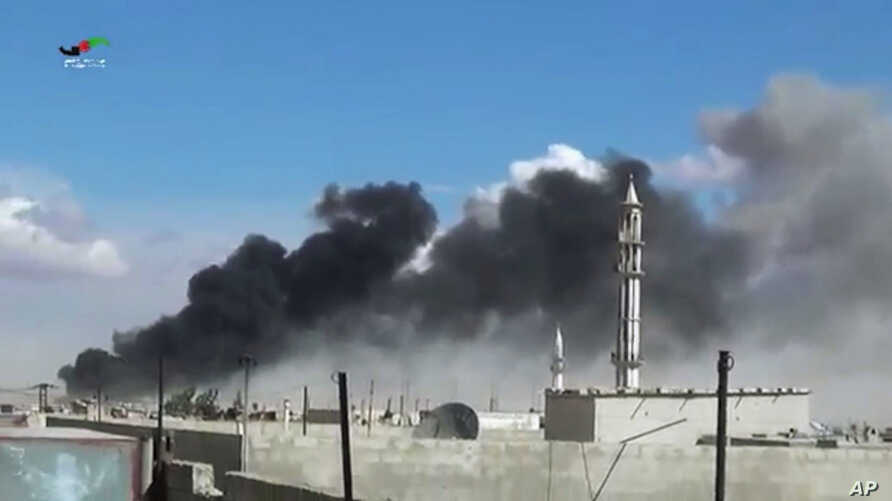 Smoke rises after airstrikes by military jets in Talbiseh, a city in western Syria's Homs province, where Russia launched airstrikes for the first time, Sept. 30, 2015. The image was made from video provided by Homs Media Center and authenticated b...