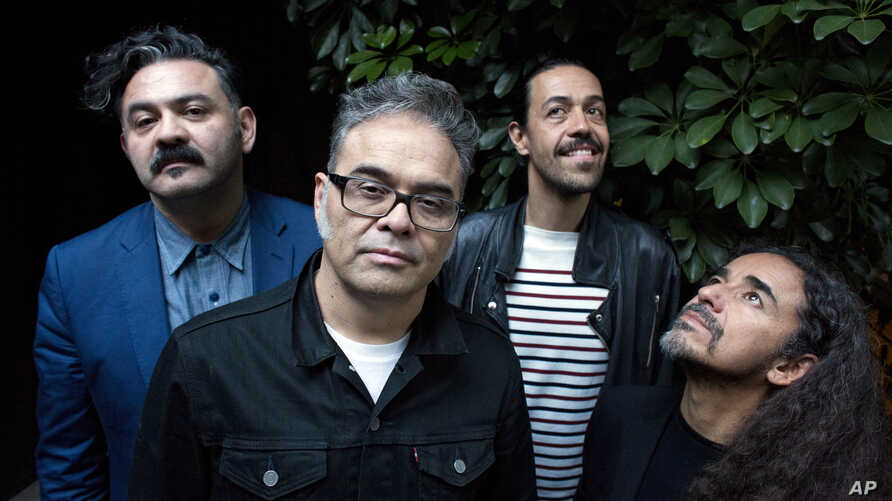 """Members of the Mexican rock band Cafe Tacvba, from left, Enrique """"Quique"""" Rangel, Jose Alfredo """"Joselo"""" Rangel, Emmanuel """"Meme"""" del Real and Ruben Isaac Albarran pose for a portrait in Buenos Aires, Argentina, April 28, 2017."""