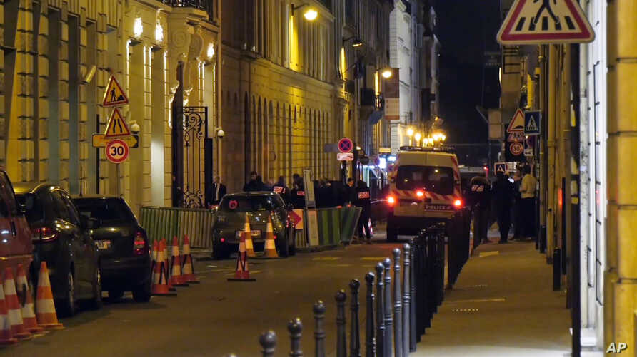 In this image made from video, French police attend the scene outside the Ritz Hotel in Paris, after a robbery Jan. 10, 2018.