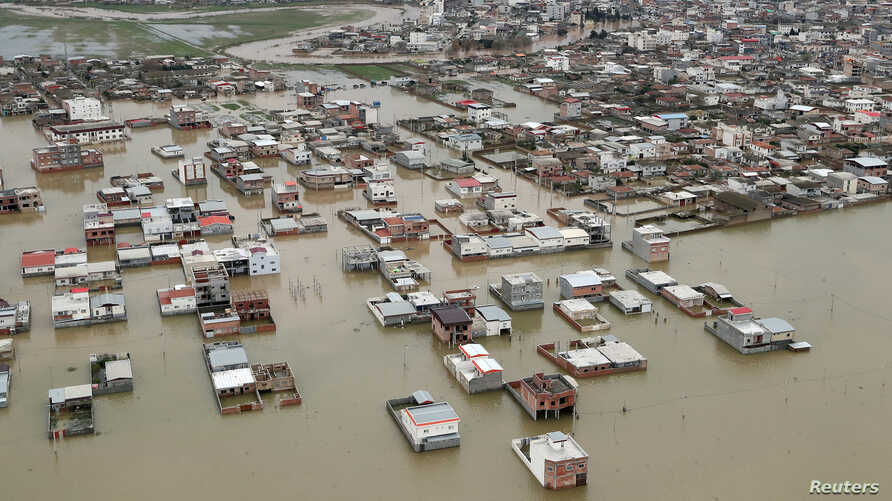 A handout photo shows an aerial view of flooding in Golestan province, Iran, March 27, 2019. (Official Iranian President website)