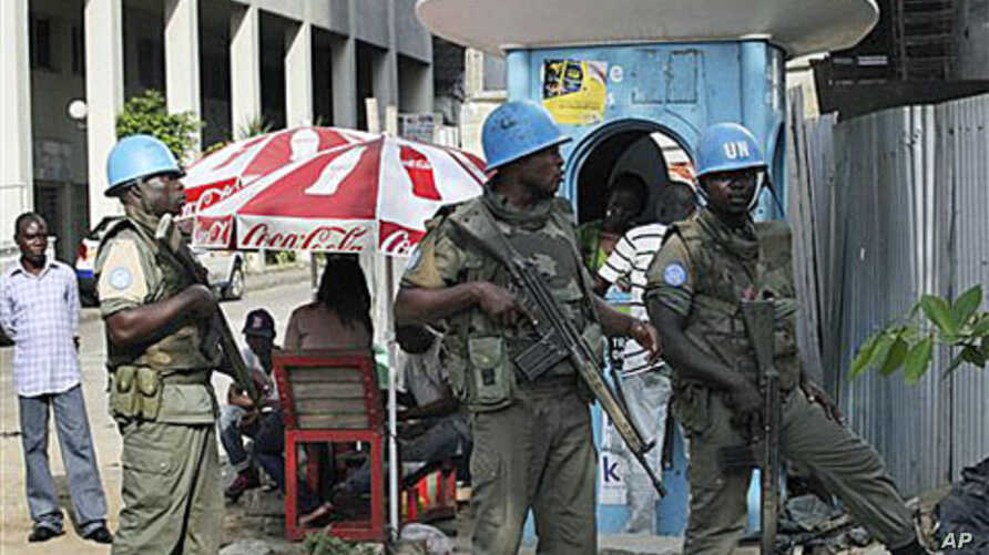 UN forces stand guard on a street in Abidjan, Ivory Coast, Dec 22, 2010