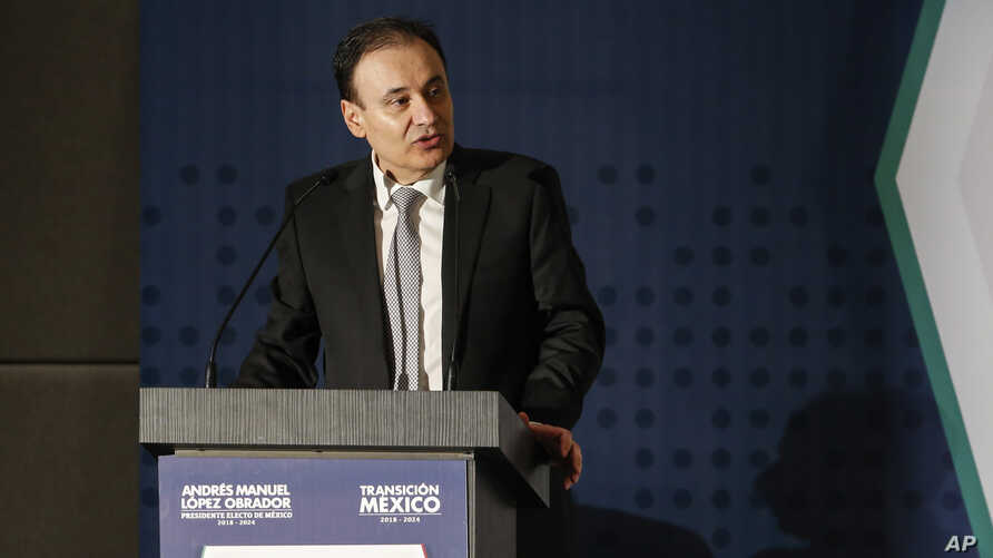 FILE - Dr. Alfonso Durazo Montano speaks about the proposed changes to national security during the national peace and security plan conference in Mexico City, Nov. 14, 2018.